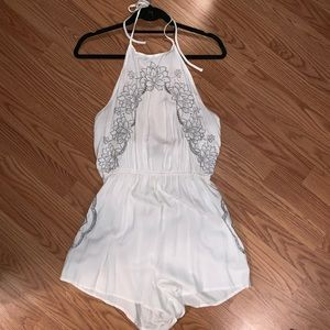 White romper with floral detail